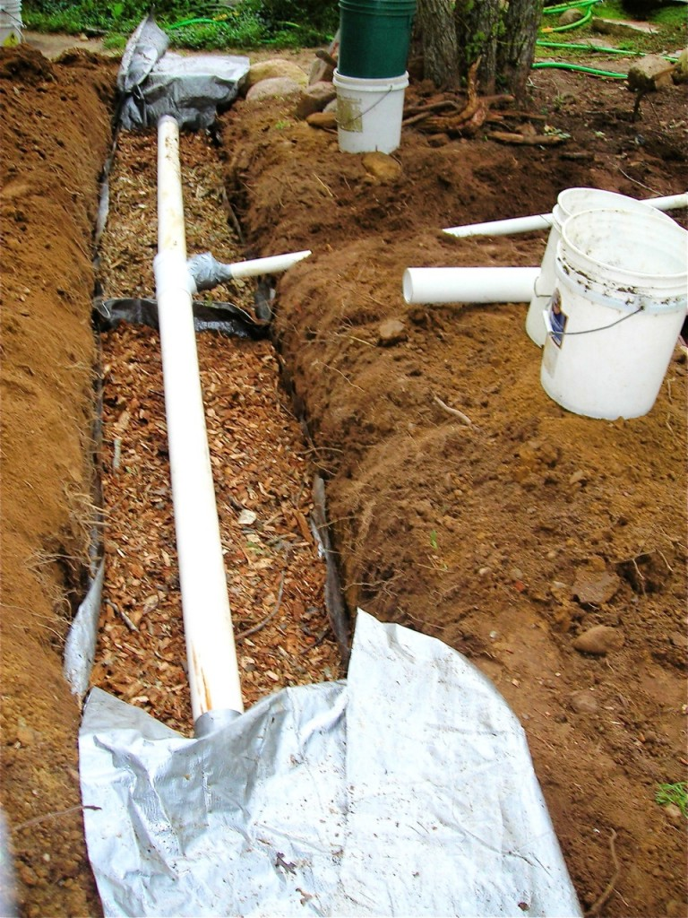 "A Solviva Greenfilter in the making: 18"" deep, lined, filled with wood chips, topped with perforated pipe."