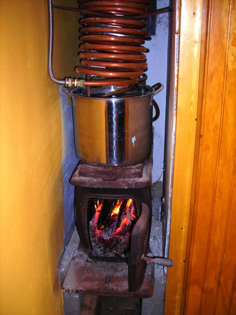 I did not dare to go 100% solar+chicken heat, so I installed this wood heating system. I tried it once, and, lo and behold, it proved to heat the pool water as effectively as the 5500-watt electric heater that came with the pool.